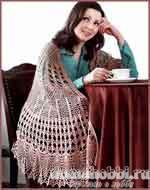 Вязаная ажурная шаль с узорными полосами